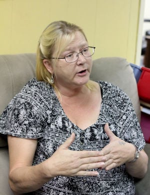Cove House: Mary Claire Huslage, a Cove House volunteer, speaks about her past Thursday at the shelter. - Herald/CATRINA RAWSON