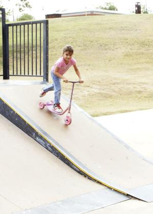 <p>Mila Adams enjoys the cool weather as she tries out the ramps Sunday, Sept. 14, 2014, at Conder Skate Park in Killeen.</p>