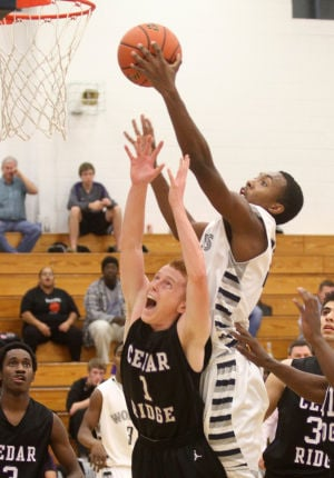 Boys Basketball: Shoemaker V. Cedar Ridge: Shoemaker's Nykolas Dawson attempts a basket against Cedar Ridge's Austin Estelle Monday night at Shoemaker. - Herald/MARIANNE GISH
