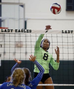 <p>Ellison's Symone Thomas (8) hits against Lampasas defenders during their match Tuesday might at Ellison High School. Thomas finished with a team-high-tying six kills in the Lady Eagles' 3-0 victory.</p>