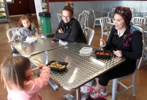 Living Here - Healthy Living: Jessica Terrazas and her daughter Elizabeth, 2, have a meal with friends Tiffany Collinge and her son Elijah, 2, Thursday, November 14, 2013 at Purefit Foods in Killeen. - Herald/CATRINA RAWSON