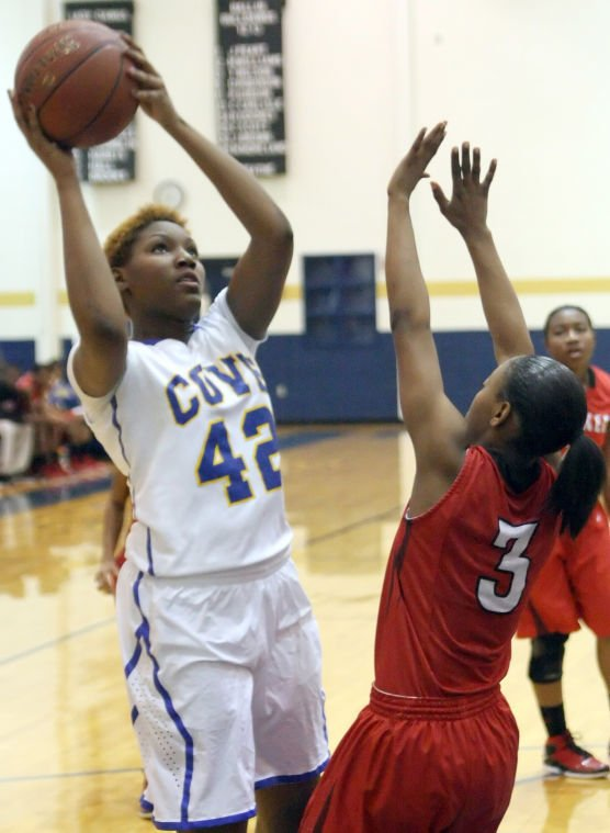 Cove holds off Heights 69-64