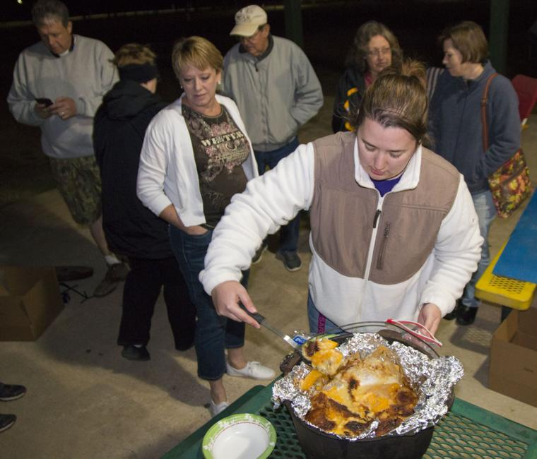 Attendees learn how to cook outdoors in a dutch oven for Award winning dutch oven dessert recipes