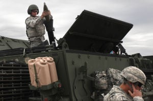 Live Fire Excercise004.jpg: Pvt. Scott Dirle places a mortar round during a comprehensive live-fire exercise with 3rd Cavalry Regiment on Friday morning. - Herald/Jaime Villanueva