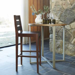 <p>Round tables like West Elm's rustic round counter table create an illusion of space.</p>