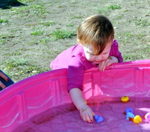 Carnival For World Hunger Relief: Riley Berens, 2, plays with ducks in a pool at the Carnival for World Hunger.