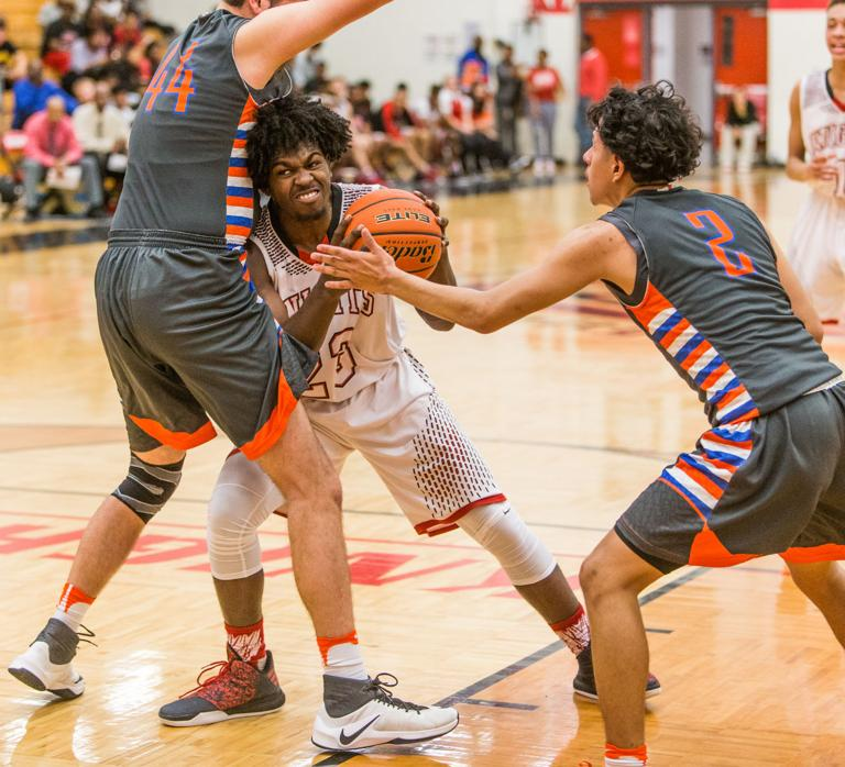 BOYS BASKETBALL: Knights race past Bobcats for 1st 8-6A win