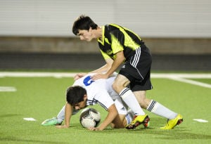 <p>Gatesville's Austin Combs, right, leans on Lampasas' Markos Terrazas during Friday night's District 34-4A match in Gatesville.</p>