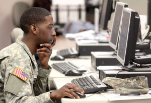<p>Second Lt. Kevin Smith, of the 1181st Deployment and Distribution Support Battalion, 1190th Transportation Brigade at Camp Shelby, Miss., registers his employment history Thursday at the Texas Veterans Commission in Killeen. Smith might be assigned to Fort Hood.</p>