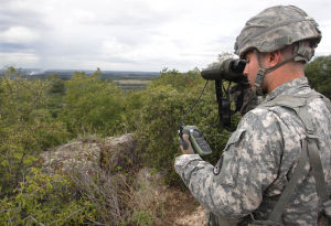 Live Fire Excercise005.jpg: Lt. Anthony Mamunes observes a target during a live-fire exercise. - Jaime Villanueva