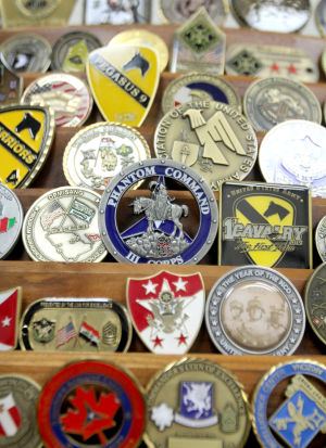 Coin Collection: Ron Taylor, senior vice president of Fort Hood National Bank, has a challenge coin collection that resides in his office, Friday, December 27, 2013 at Fort Hood National Bank at Fort Hood. - Herald/CATRINA RAWSON