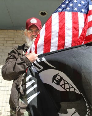Vietnam vets raise flag that once flew in Iraq