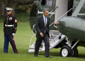 Barack Obama Headed To Texas: President Barack Obama walks from the Marine One helicopter on the South Lawn of the White House in Washington, Tuesday, Nov. 5, 2013, to the Oval Office after a trip to Walter Reed National Military Medical Center to visit with wounded troops. The president will be in Dallas today talking about health care. - Photo by AP Photo/ Evan Vucci