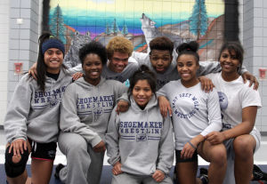 Shoemaker State Wrestlers: Members of the Shoemaker state wrestling contingent pose before practice Thursday at Shoemaker. They are, from left to right, Ruth Edwin (alternate), Harmony Maitland, Darnell Everett, Deedrah Cattousse (alternate), Khalil Bryant, Maya Little and Anne Ford. - Jaime Villanueva
