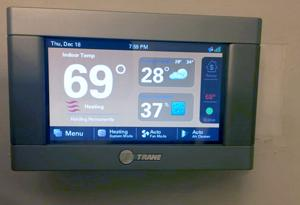 What temperature should you set the thermostat to while away?
