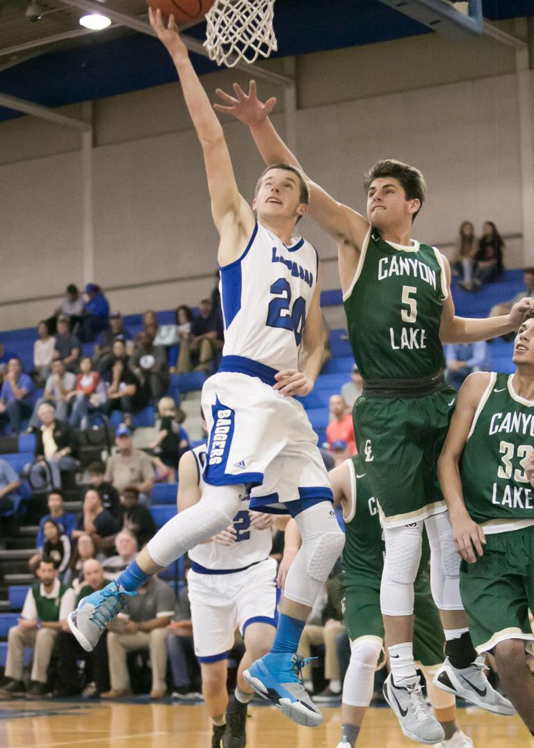 BOYS BASKETBALL: Badgers pick up the slack for foul-plagued star in home opener