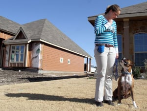 Biz Twist Of Fate Dog Training.Jaime Villanueva 005.jpg: Leslie Dalton, owner of Twist of Fate Dog Training, walks her dog Barley on Friday afternoon in Killeen. - Jaime Villanueva