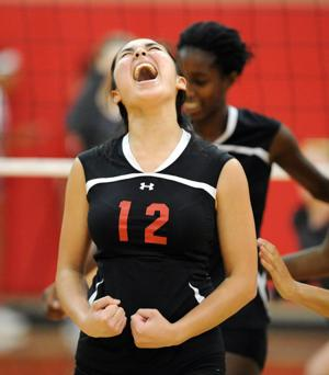 <p>Harker Heights' Selicia Field celebrates after winning a point against Salado on Tuesday in Salado. The Lady Knights outlasted Salado to win in five sets.</p>