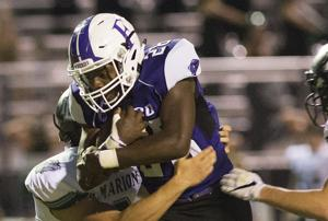 <p>Florence running back Edel Hernandez carries against Marion on Friday in Florence.</p>
