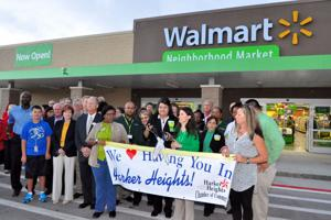 <p>The new Wal-Mart Neighborhood Market opened Wednesday Oct. 1, 2014, following a ribbon-cutting. The 41,000-square-foot grocery store is located at 960 E. Farm-to-Market 2410. On-hand were Wal-Mart employees and Harker Heights Chamber of Commerce officials.</p>