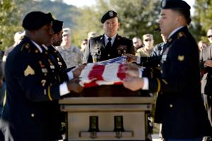 <p>Staff Sgt. Joshua Borst stands at the head of Army Veteran Mr. Galen Pearson as the American flag covering his casket is folded at the Central Texas State Veterans Cemetery, Wednesday, Nov. 30, 2016.</p>