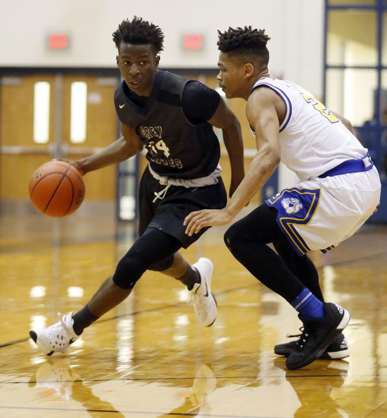 BOYS BASKETBALL: Wolves' returning three to talented unit