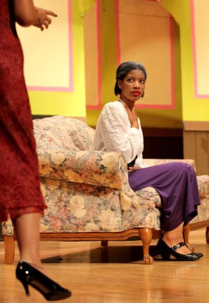 Killeen High School Murder Mystery Production: Jonicia Blackburn who plays the part of Margaret Craddock speaks with Courtney Benitez who plays the part of Mildred during the production of