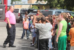Halstead Elementary School Fire Prevention Presentation: Lt. James Bednar a firefighter with the Copperas Cove Fire Department, speaks to students and teachers from Halstead Elementary School during a fire prevention presentation put on by the Copperas Cove Fire Department, Thursday, October 10, 2013 at Halstead Elementary School in Copperas Cove. - Herald/CATRINA RAWSON