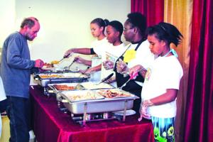 Church shares bounty with community feast