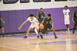 <p>Shoemaker-Deondre Hopkins (3) and a Waco University player battle over the ball</p>