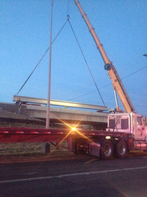 Overpass beam placed on U.S. 190