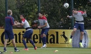 <p>Brad Davis, of the United States, right, heads a soccer ball tossed by head coach Jurgen Klinsmann during a training session Monday in Sao Paulo. The United States will play Germany in Group G of  the World Cup on Thursday in Recife, Brazil.</p>