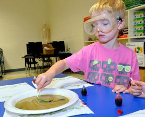 <p>Jayden Stahley, 4, of Mae Stevens Early Learning Academy, mixes food coloring with milk as part of an experiment Oct. 22 at Mae Stevens Early Learning Academy in Copperas Cove.</p>