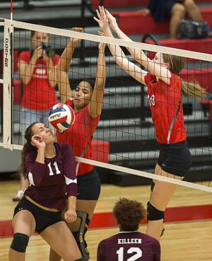 <p>Killeen's Sabrina Garcia, left, tries to make a play on a Lady Roos hit that was blocked by Belton's Brey York, center, and Allison Waits during Tuesday's match in Belton.</p>