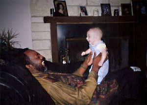 500th Scott & White Transplant Patient: Johnny Ray Watson, the 500th transplant patient of the Scott & White kidney/pancreas transplant program, is seen many years ago holding Caleb Tate. Less than a month ago, Tate died in a motorcycle accident and Watson received one of Tate's kidneys. - Courtesy photo