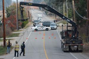 Truck vs power lines, closes road