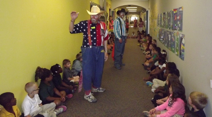 Rodeo clowns visit with few children