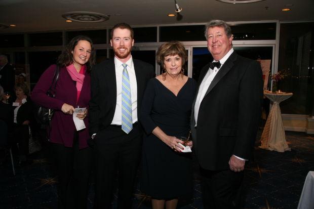 Brandi and Dan Burke, Julie and Scott Schnuck