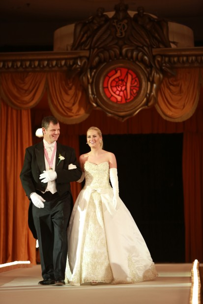 Allison Sloan Perry, daughter of Mr. and Mrs. Russell Perry, escorted by Gregory Trapp