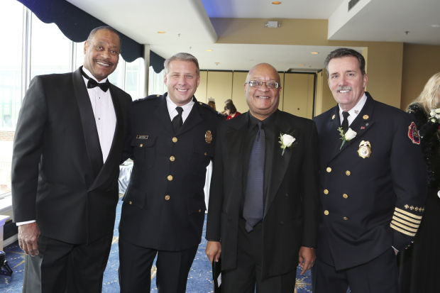 Donn Johnson, St. Louis Police Chief Sam Dotson, Rev. Earl Nance, St. Louis Fire Chief Dennis Jenkerson