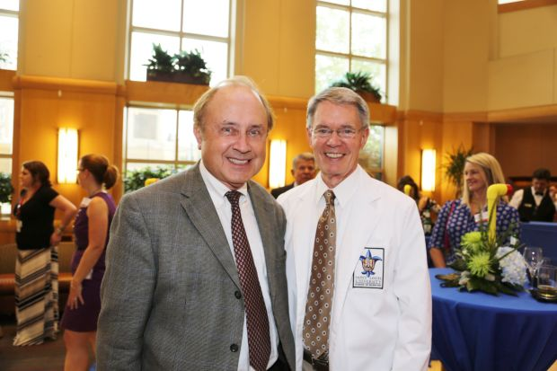 Dr. Robert Wilmott chair of pediatrics, Philip Alderson dean of medical school