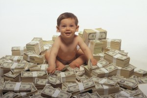Baby sitting on money