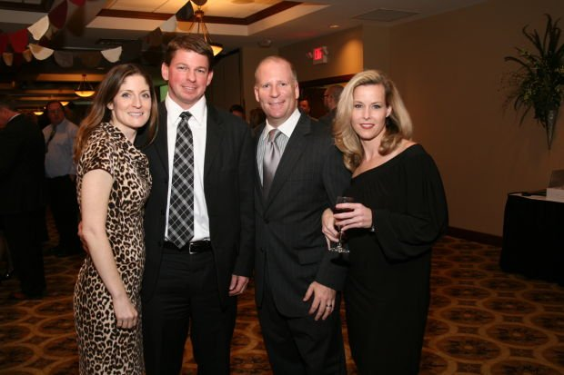 Susan and Richard Moore, Sen. Scott and Carissa Rupp