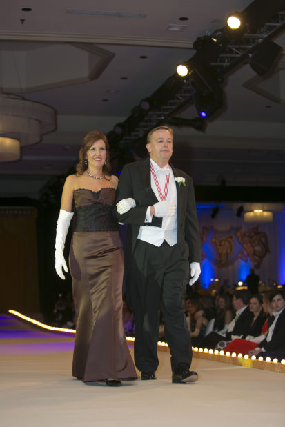 Lady of Honor Mrs. James J. Wotruba and her escort, Mark Stegmann
