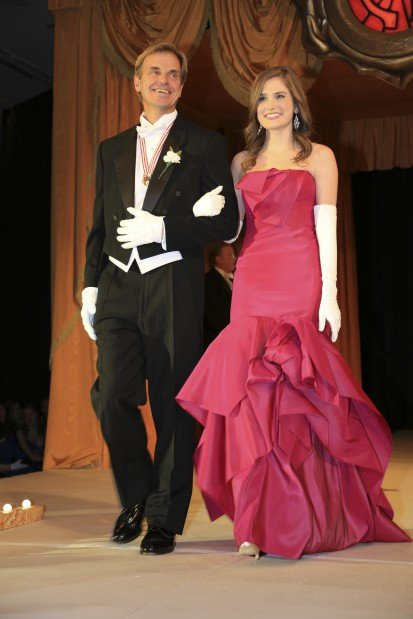Catherine Ashby Hagedorn, daughter of Mr. and Mrs. Richard Hagedorn, escorted by John Eisenbeis
