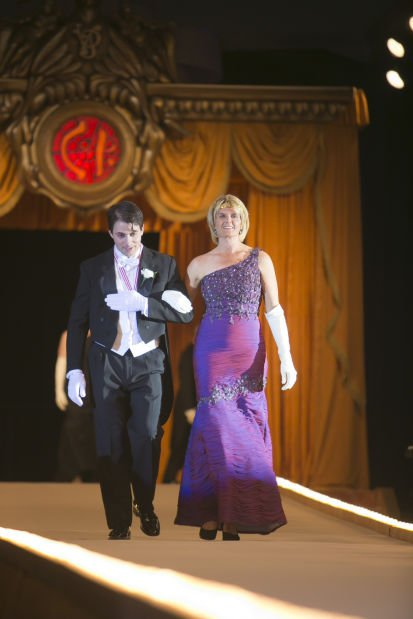 Former Queen Mrs. Alice Behan Christopher and her escort, John Kingston