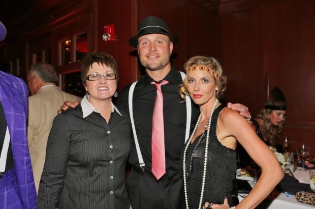 LuAnn Bott president and CEO, Matt and Leslee Holliday