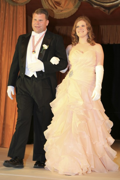Marie Claire Dwyer, daughter of Dr. and Mrs. Jerome Dwyer, escorted by Adam Jokisch