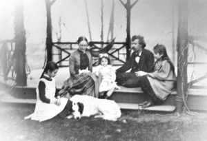 1289926938-The Mark Twain House -- The Clemens family on the porch, 1885. Left to right -- Clara Clemens, Olivia Langdon Clemens, Jean Clemens, Samuel L. Clemens, Susy Clemens.jpg