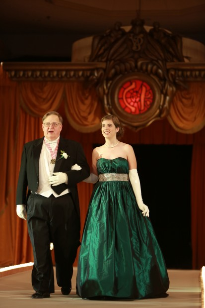 Elaine Augustin Maskus, daughter of Mr. and Mrs. Michael Maskus, escorted by William Gilbert II